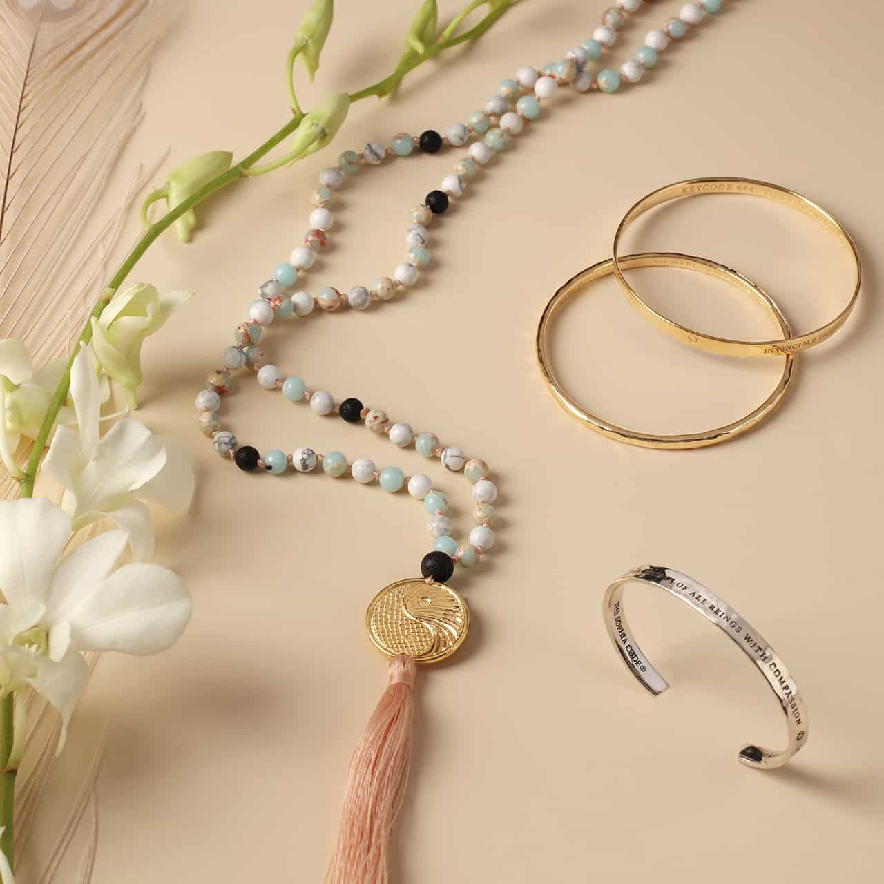 quan yin jewelry with flowers